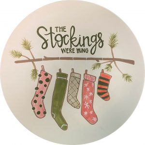 Christmas Stockings hanging on a tree branch plate